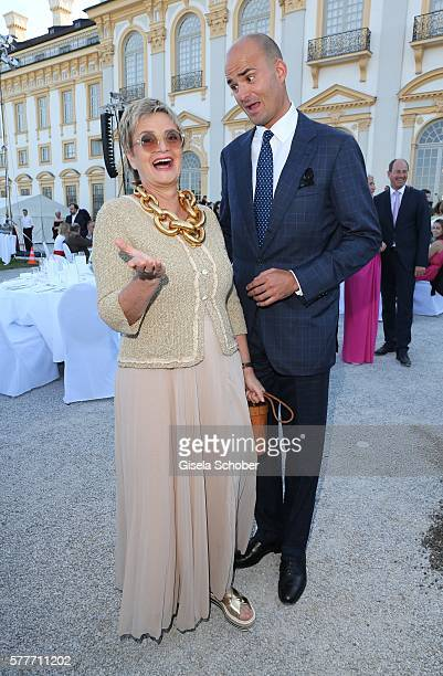 Fuerstin Gloria von Thurn und Taxis and her son Prince Albert von Thurn und Taxis laugh during the Summer Reception of the Bavarian State Parliament...