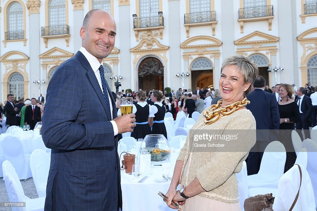 Fuerstin Gloria von Thurn und Taxis and her son Prince Albert von Thurn und Taxis laugh during the Summer Reception of the Bavarian State Parliament (Empfang des Bayerischen Landtags) at Schleissheim Palace on July 19, 2016 in Munich, Germany.