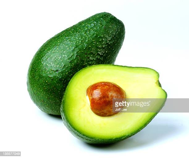 Fuerte avocado cut in half with stone exposed