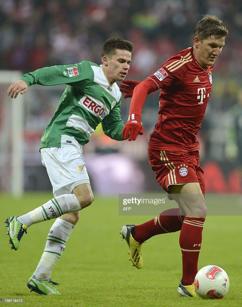 Fuerth's midfielder Zoltan Stieber (L) and Bayern Munich's midfielder Bastian Schweinsteiger (R) vie for the ball during the German first division Bundesliga football match FC Bayern Munich vs Greuther Fuerth in Munich, southern Germany, on January 19, 2013.