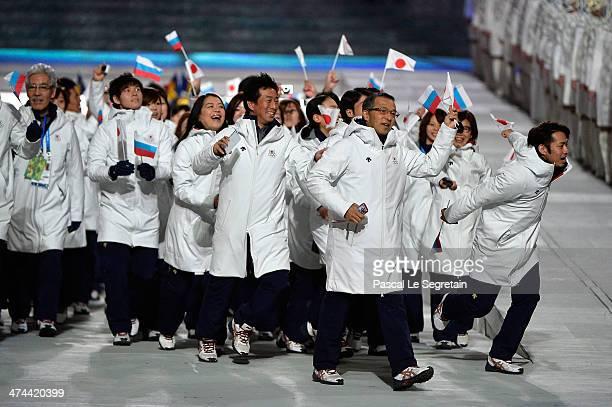 Fugure skater Daisuke Takahashi and Team Japan athletes enter during the 2014 Sochi Winter Olympics Closing Ceremony at Fisht Olympic Stadium on...