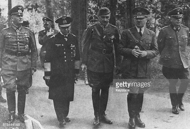 Fuhrer Adolf Hitler walking with a group of German officers Wilhelm Keitel Admiral Erich Raeder Carl von Mannerheim and Dr Hans Lammers June 27th 1942