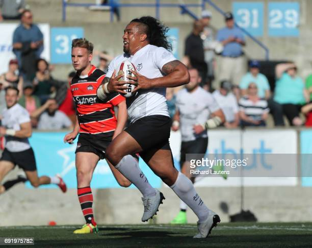 TORONTO ON JUNE 3 Fui Fui Moi Moi runs in for a try late in the game Canada's first professional rugby team the Toronto Wolfpack beat the Coventry...