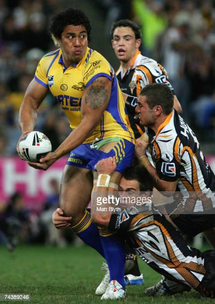 Fuifui Moimoi of the Eels looks to offload the ball during the round 12 NRL match between the Wests Tigers and the Parramatta Eels at Telstra Stadium...