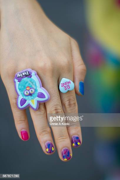 Fuji Asahi is seen on Harajuku St with multicolored pastel nails and plastic Claire's rings on August 07 2016 in Tokyo
