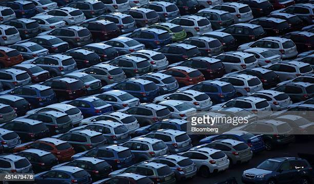 Fuji Heavy Industries Ltd Subaru branded vehicles bound for shipment sit in a lot at night in Kawasaki Kanagawa Prefecture Japan on Thursday June 19...
