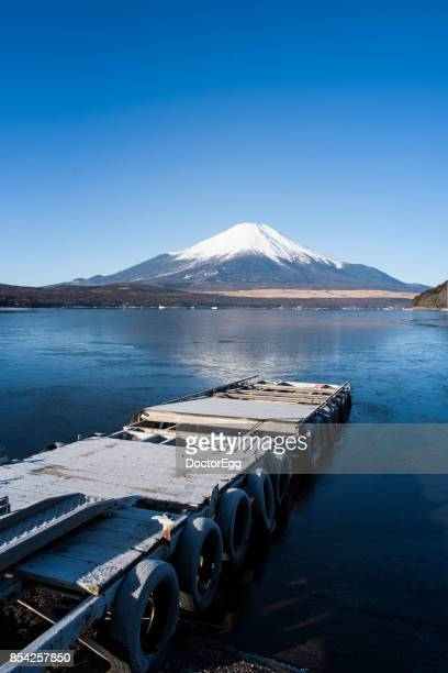 Fuji Mountain Reflection with Blue Sky at Yamanaka Lake in Winter