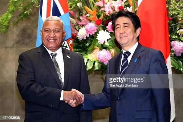 Fuji Prime Minister Josaia Voreqe Bainimarama commonly knowns as Frank Bainimarama shakes hands with Japanese Prime Minister Shinzo Abe during their...