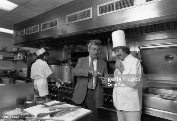 Fujicolor 100 @ 100 ASA Electronic flash Sebanton Restaurant owner Philipe Colom talks with chef Pierre Jenatton in the kitchen of his Longmont...