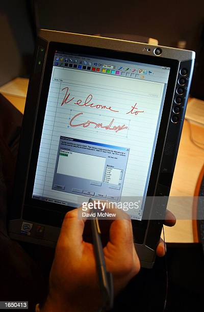 Fujitsu exhibitor Alan Fulcher converts handwritten text to type on a Stylistic 3110 tablet PC at the COMDEX Fall 2002 computer technology trade show...