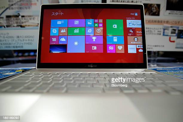 A Fujitsu Ltd FMV Lifebook laptop computer running Microsoft Corp's Windows 81 operating system is displayed during a launch event for the operating...