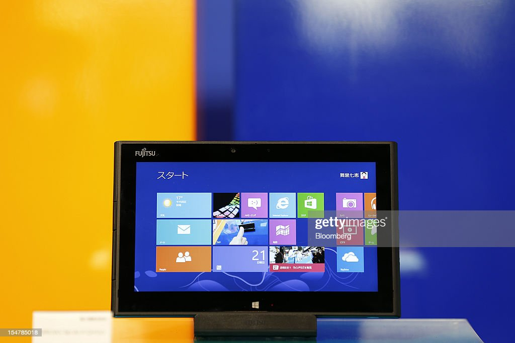 Fujitsu Ltd's Arrows Tab WiFi QH55/J tablet computer running Microsoft Corp's Windows 8 operating system sits on display during a launch event in...