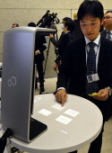 Fujitsu researcher Taichi Murase demonstrates a new user interface using fingertip operation at the company's laboratory in Kawasaki suburban Tokyo...