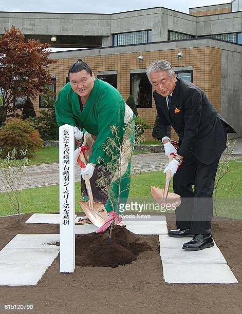 Fukagawa Japan Mongolian yokozuna sumo wrestler Hakuho takes part in the planting of a seaberry plant seedling on the campus of Takushoku University...