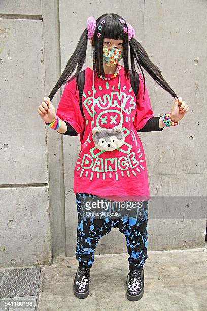 Fukami Yaan is wearing a SUPER LOVERS LOVER ' SROCK pink and green shirt platform cowhide dress shoes black and blue graphic drop crotch joggers...