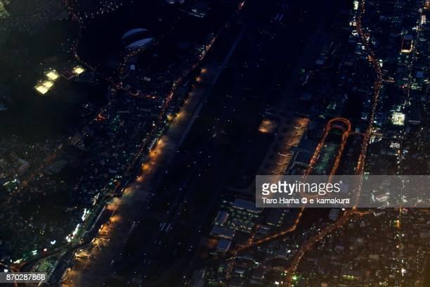 Fukuoka International Airport night time aerial view from airplane