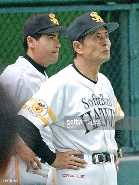 Japan's professional baseball team Softbank Hawks manager Sadaharu Oh and head coach Hiroshi Moriwaki watch the game between Hawks and Seibu Lions at...