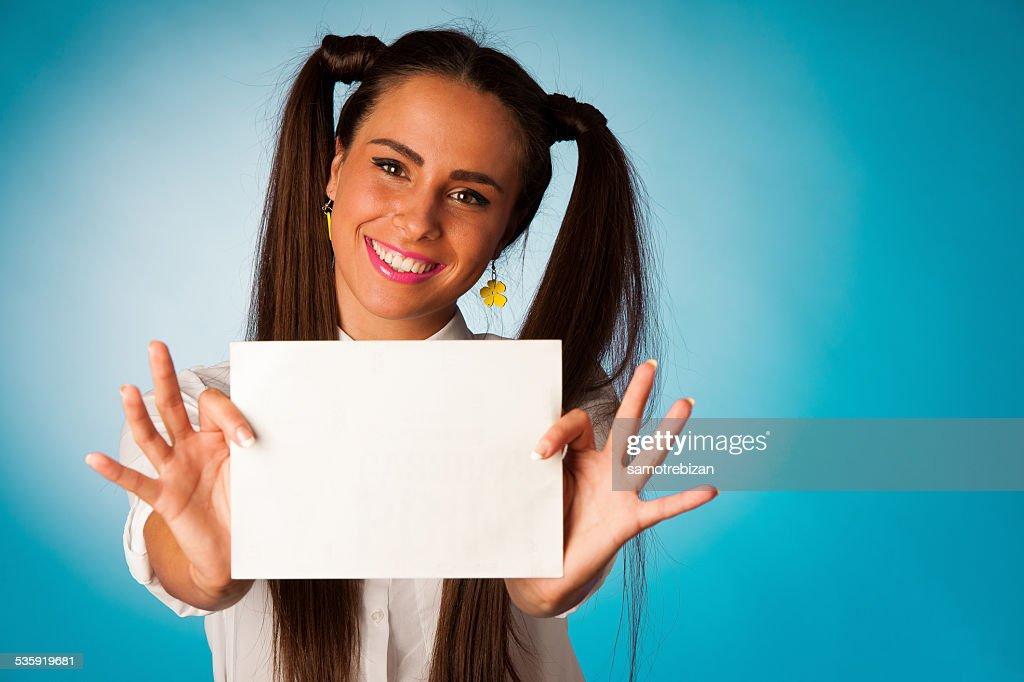 ful hispanic business woman holding blank card : Stock Photo