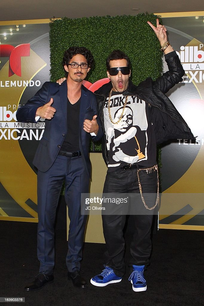 Fulano (L) and Mengano pose for a photograph at The 2013 Billboard Mexican Music Awards - Press Room at Dolby Theatre on October 9, 2013 in Hollywood, California.