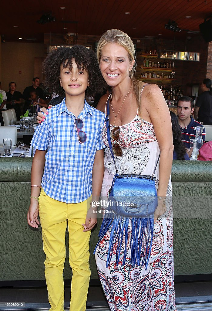 DJ Fulano poses with <a gi-track='captionPersonalityLinkClicked' href=/galleries/search?phrase=Dina+Manzo&family=editorial&specificpeople=5841104 ng-click='$event.stopPropagation()'>Dina Manzo</a> at his 11th birthday party at Rooftop 48 on July 12, 2014 in New York City.
