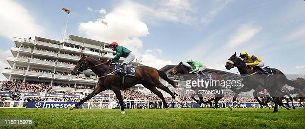 Fulbright ridden by Silvestre De Sousa crosses the line to win the Woodcote Stakes race on Derby Day the second day of the Epsom Derby in Surrey...