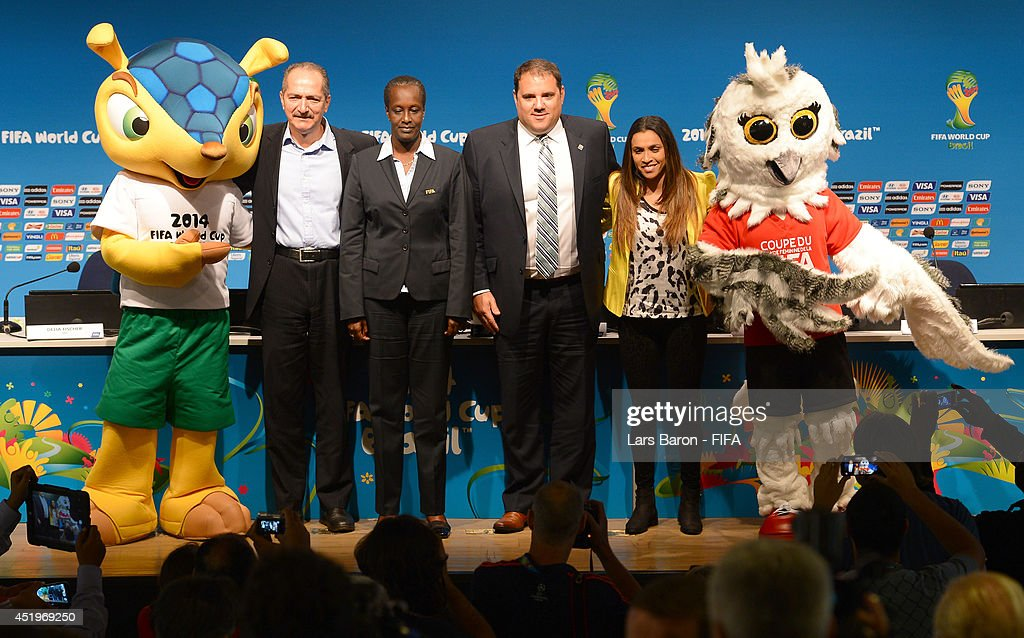 Fuleco, mascot of the FIFA World Cup Brazil 2014, <a gi-track='captionPersonalityLinkClicked' href=/galleries/search?phrase=Aldo+Rebelo&family=editorial&specificpeople=772117 ng-click='$event.stopPropagation()'>Aldo Rebelo</a>, Brazil's Minister of Sports, Lydia Nsekera, FIFA Executive Committee member and Chair of the Committee for Women's Football and FIFA Women's World Cup, <a gi-track='captionPersonalityLinkClicked' href=/galleries/search?phrase=Victor+Montagliani&family=editorial&specificpeople=11212873 ng-click='$event.stopPropagation()'>Victor Montagliani</a>, Chairman of the National Organising Committee FIFA Women's World Cup Canada 2015, Marta, Brazil star and FIFA World Cup ambassador representing the Local Organising Committee, and Shueme, mascot of the FIFA Women's World Cup Canada 2015, pose for a picture after a FIFA Women's World Cup Canada 2015 press conference during the FIFA daily media briefing at Maracana on July 10, 2014 in Rio de Janeiro, Brazil.