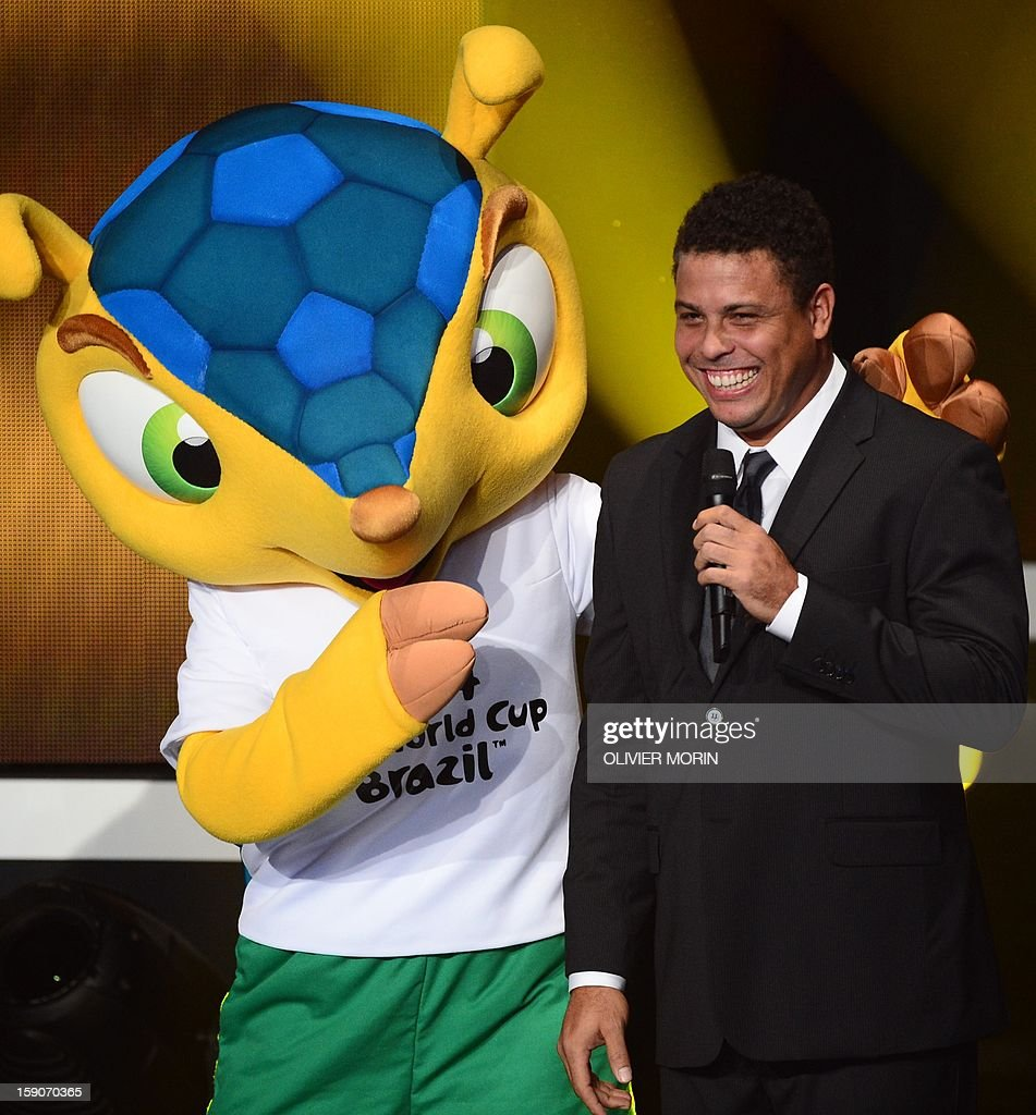 Fuleco, the mascot for Brazil 2014 World cup (L) and Brazilian former international Ronaldo joke on stage during the FIFA Ballon d'Or awards ceremony at the Kongresshaus in Zurich on January 7, 2013.