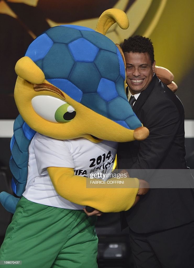 Fuleco, the mascot for Brazil 2014 World cup (L) and Brazilian former international Ronaldo hug on stage during the FIFA Ballon d'Or awards ceremony at the Kongresshaus in Zurich on January 7, 2013.