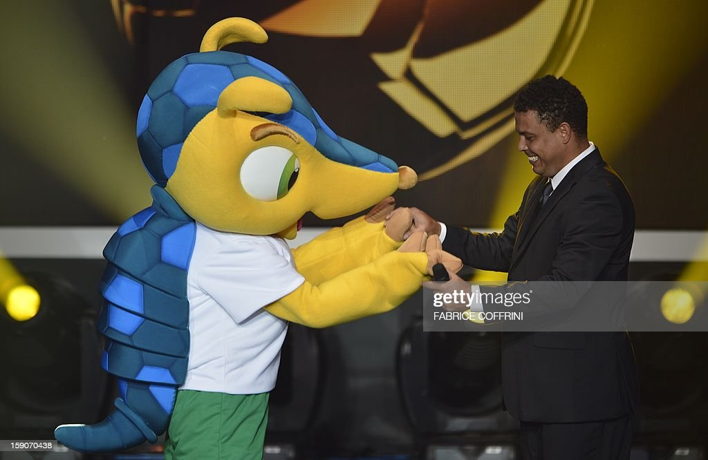 Fuleco, the mascot for Brazil 2014 World cup (L) and Brazilian former international Ronaldo arrive on stage during the FIFA Ballon d'Or awards ceremony at the Kongresshaus in Zurich on January 7, 2013.