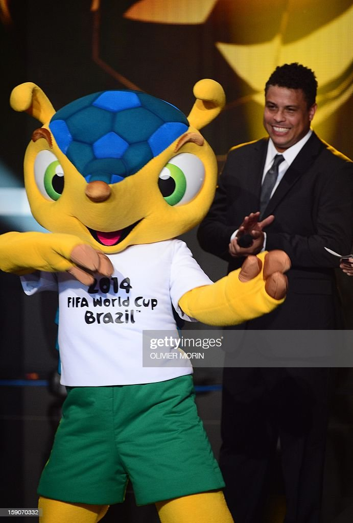 Fuleco, the mascot for Brazil 2014 World cup dances on stage by Brazilian former international Ronaldo during the FIFA Ballon d'Or awards ceremony at the Kongresshaus in Zurich on January 7, 2013.