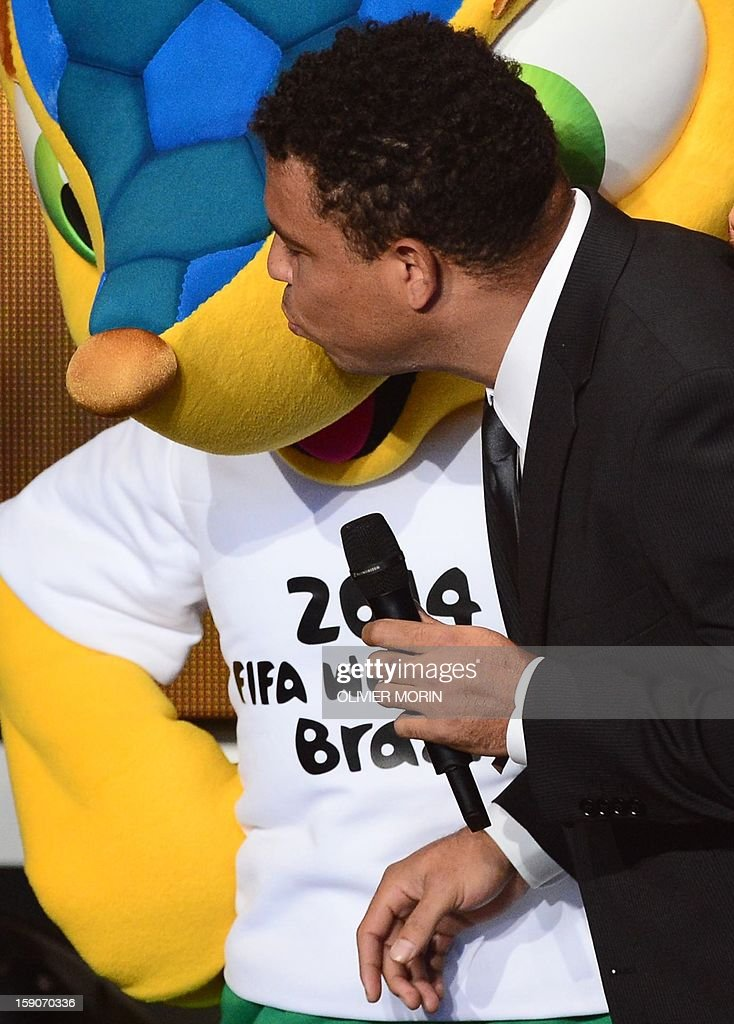 Fuleco, the mascot for Brazil 2014 World cup (L) is kissed by Brazilian former international Ronaldo joke on stage during the FIFA Ballon d'Or awards ceremony at the Kongresshaus in Zurich on January 7, 2013.