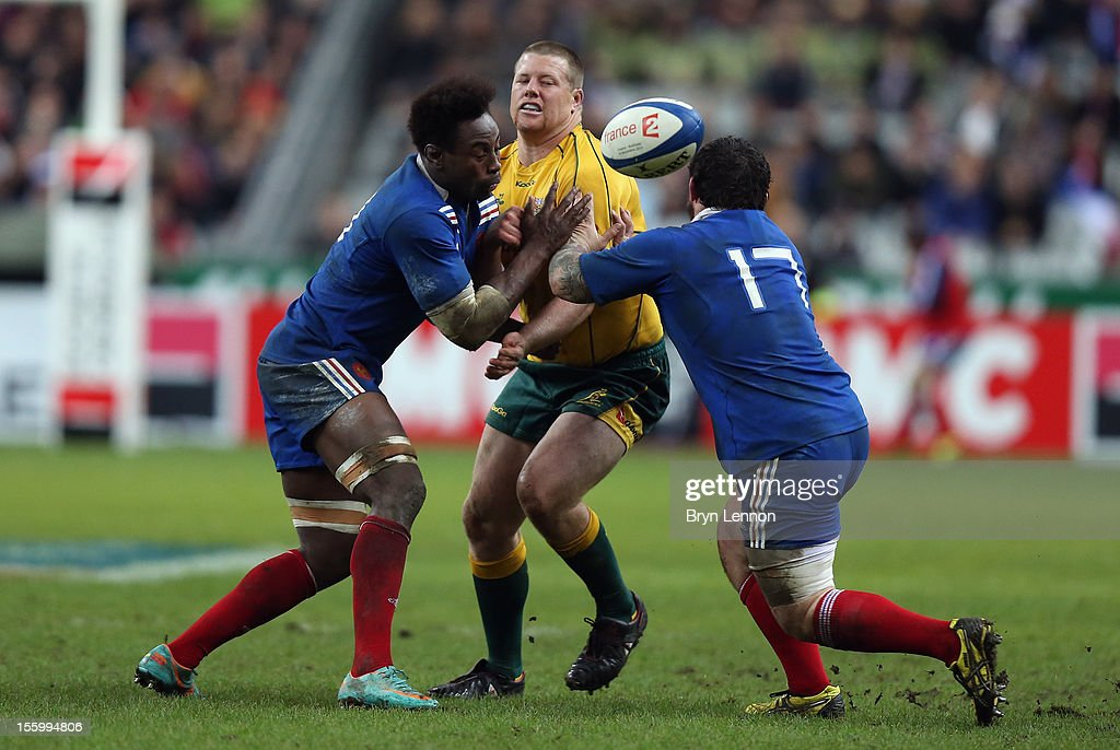 Fulgence Ouedraogo and Thomas Domingo of France tackle Paddy Ryan of Australia during the Autumn International match between France and Australia at Stade de France on November 10, 2012 in Paris, France.