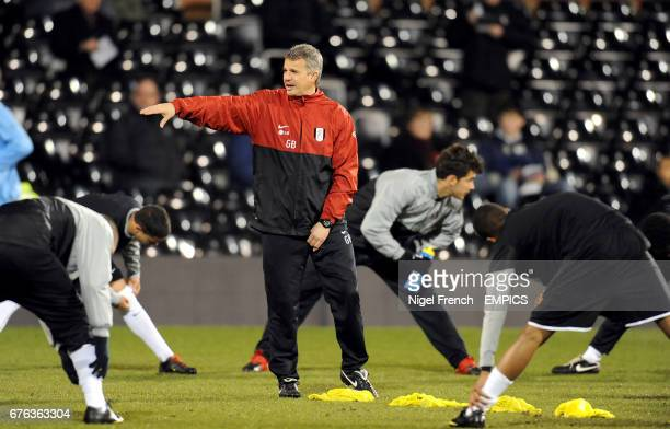 Fulham Academy manager Gary Brazil oversees the pre match warm up