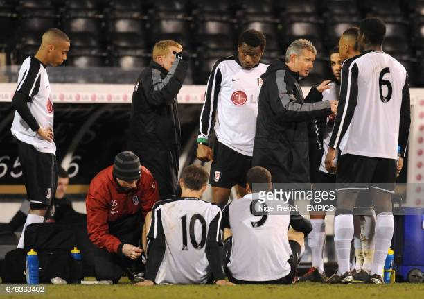 Fulham Academy manager Gary Brazil talks to his players before the penalty shoot out