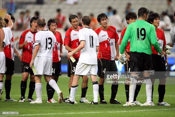 Fulham and Busan Icans' players shake hands prior to the game