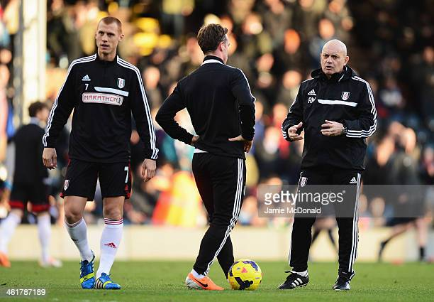 Fulham assistant head coach Ray Wilkins talks with Scott Parker and Steve Sidwell during the Barclays Premier League match between Fulham and...