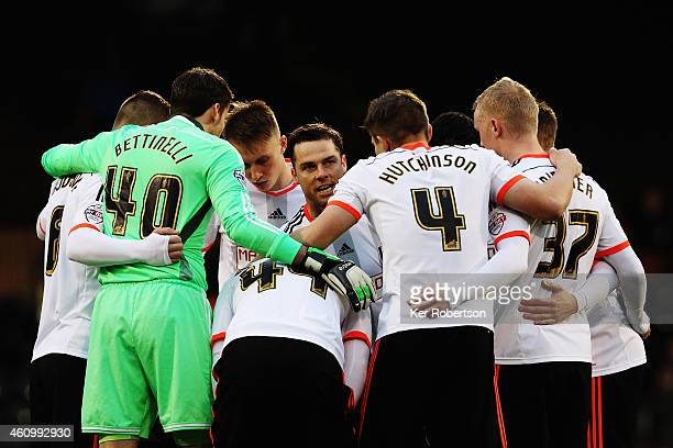 Fulham captain Scott Parker talks to his team mates before the FA Cup Third Round match between Fulham and Wolverhampton Wanderers at Craven Cottage...