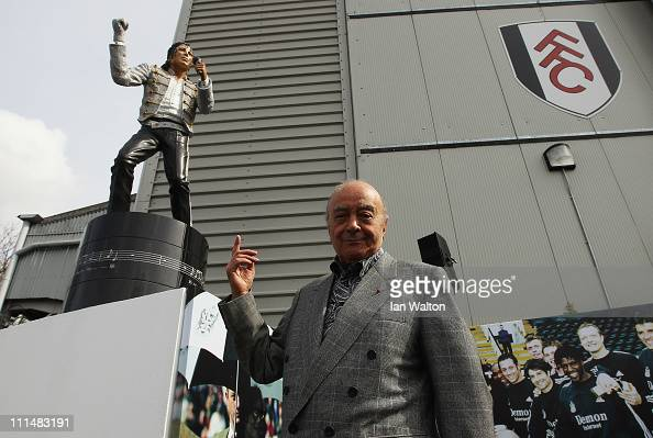 Fulham chairman Mohamed Al Fayed unveils a statue in tribute to Michael Jackson prior to the Barclays Premier League match between Fulham and...