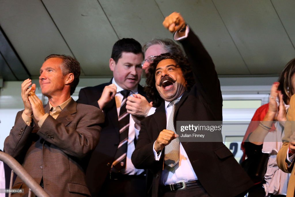 Fulham Chairman Shahid Khan celebrates after Steve Sidwell of Fulham scores their team'ssecond goal during the Barclays Premier League match between...