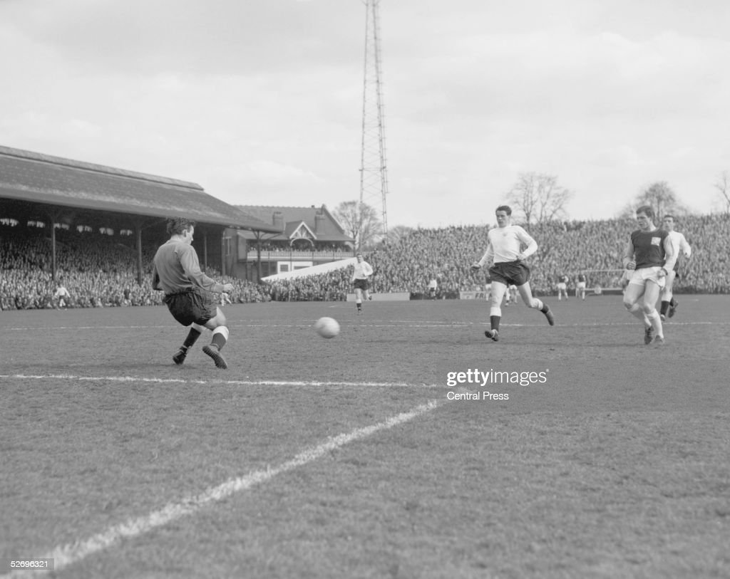 Fulham FC's righthalf Bobby Robson takes a shot at goal during a match against West Ham at Craven Cottage 16th April 1964