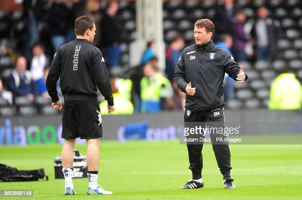 Fulham first team coach Billy McKinlay speaks with a teammate