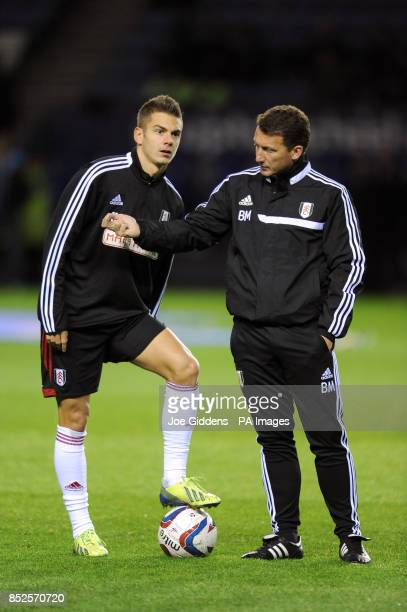 Fulham first team coach Billy McKinlay with Alex Kacaniklic during the warmup