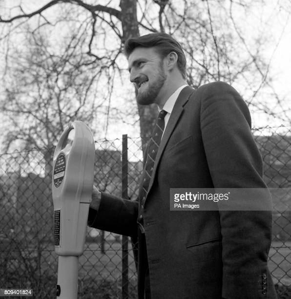Fulham footballer and chairman of the Professional Footballers' Association Jimmy Hill puts his coin in a parking meter in St James's Square London...