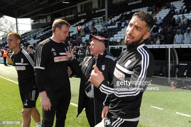 Fulham goalkeeper David Stockdale is interviewed by David Hamilton as teammates Steve Sidwell and Ashkan Dejagah look on