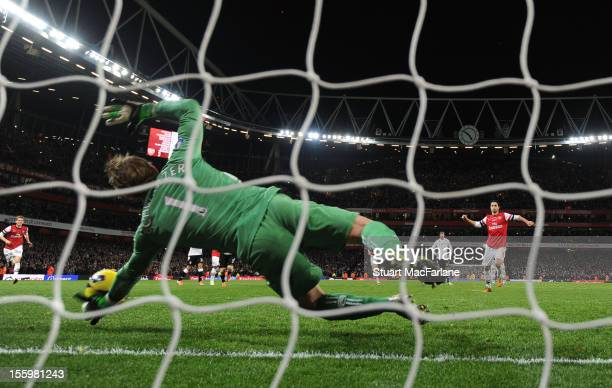 Fulham goalkeeper Mark Schwarzer saves Arsenal midfielder Mikel Arteta's last minute penalty during the Barclays Premier League match between Arsenal...
