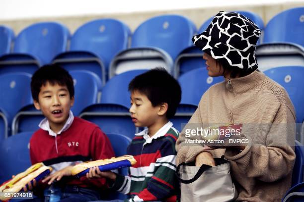 Fulham japanese fans enjoy the game and a hotdog
