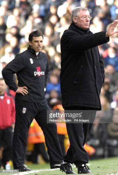 Fulham manager Chris Coleman shows his frustration as Manchester United manager Alex Ferguson instructs players