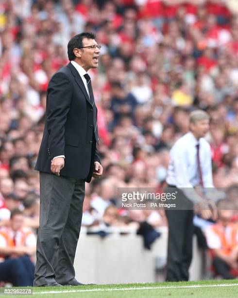 Fulham manager Lawrie Sanchez and Arsenal's Arsene Wenger on the touchline