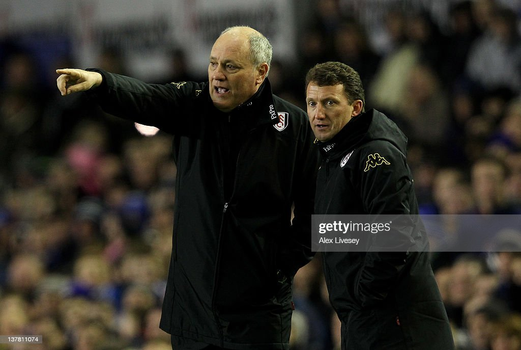 Fulham Manager Martin Jol and Coach Billy McKinlay (R) issue instructions during the FA Cup Fourth Round match between Everton and Fulham at Goodison Park on January 27, 2012 in Liverpool, England.