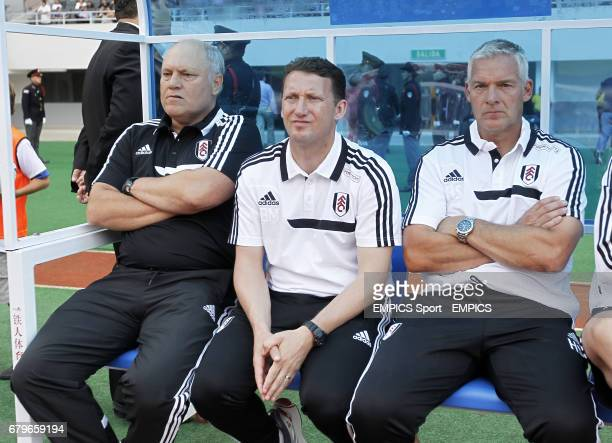 Fulham manager Martin Jol assistant Billy McKinlay and goalkeeper coach Hans Segars sit on the bench